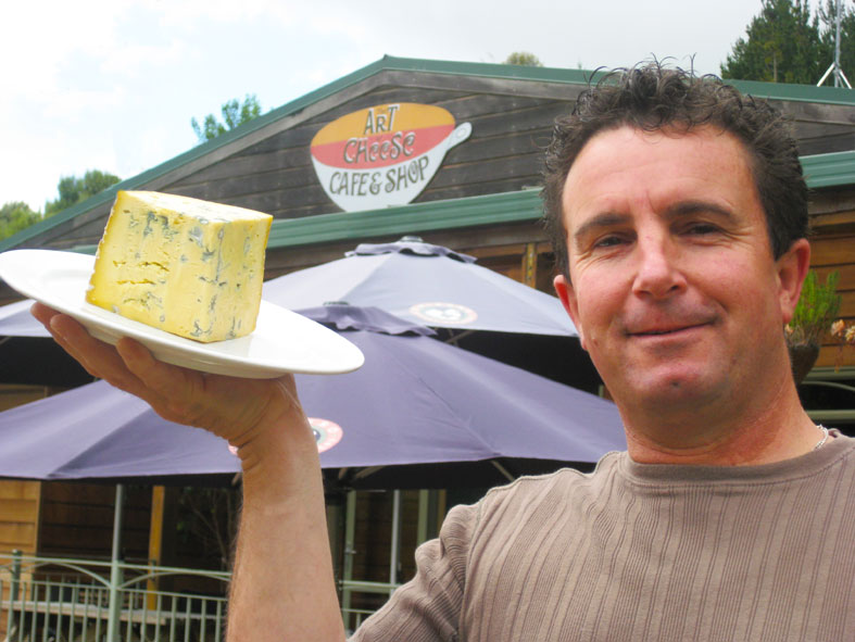 Say cheese. Shop owner in Puhoi.