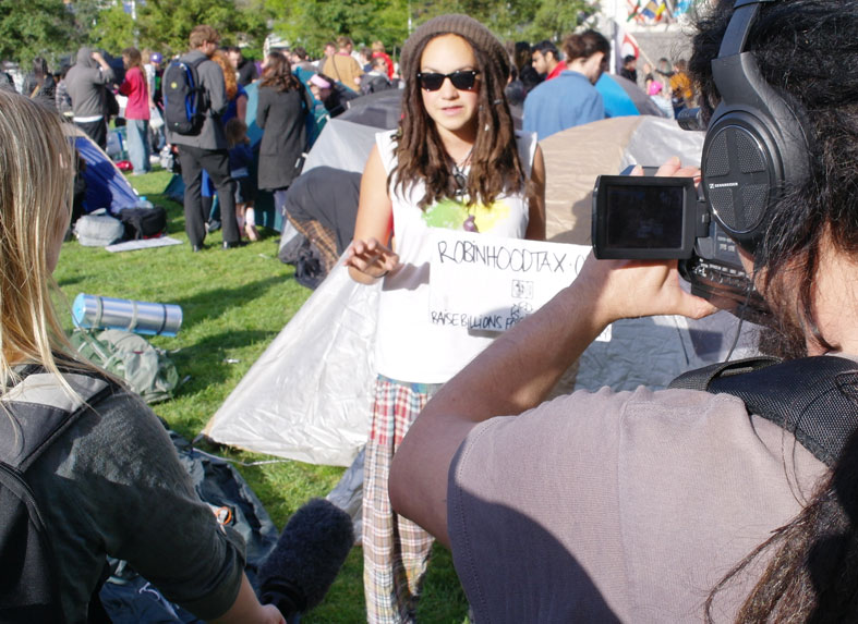 An 'occupy' protester gives a TV interview in Auckland.